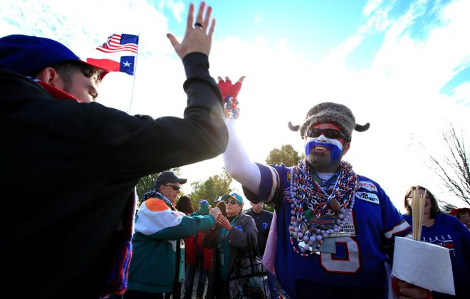 Captain Buffalo, pictured high-fiving a fellow Bills fan before the game. Buffalo football fans left happy after overcoming a rough first half. (Harry Scull Jr./Buffalo News)