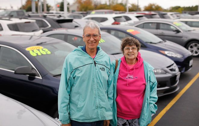 Gary and Christine Carlson of Cheektowaga were delivering The Buffalo News on Oct. 5 when their car started on fire and was totalled. With help from the customers on their route and from West Herr in Hamburg, the couple is shopping for a new car. (Derek Gee/Buffalo News)