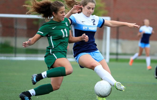 St. Mary's player Shae O'Rourke and Nichols Sophia Jones battle for a ball. (Harry Scull Jr./Buffalo News file photo)