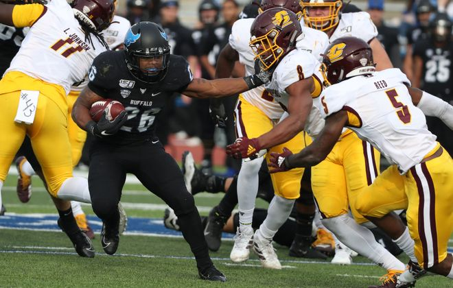 Buffalo Bulls running back Jaret Patterson (26) rushes for a first down over Central Michigan Chippewas defensive lineman LaQuan Johnson (11) in the first quarter at UB Stadium on Saturday, Oct. 26, 2019. (James P. McCoy/Buffalo News)
