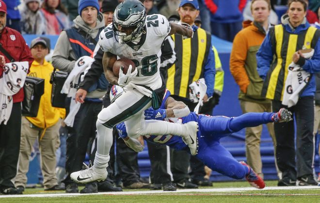 Eagles running back Mile Sanders contributed 74 yards to his team's rushing total of 218 yards Sunday against the Buffalo Bills. (Derek Gee/Buffalo News)