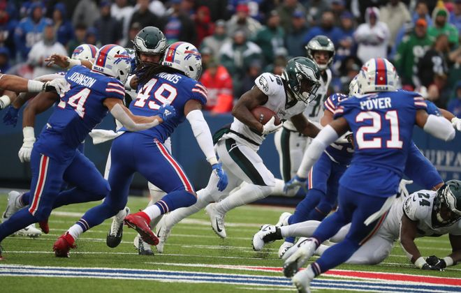 Philadelphia Eagles running back Miles Sanders beats the Bills for a 65-yard touchdown run in the third quarter at New Era Field. (James P. McCoy/Buffalo News)