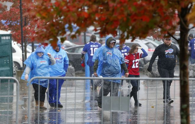 Wind and rain pound Bills fans on Sunday; there could be more of that coming later this week. (Mark Mulville/Buffalo News)