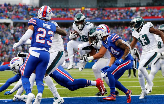 Eagles running back Miles Sanders leaps into the end zone for the two-point conversion in the second quarter Sunday. (Mark Mulville/Buffalo News)