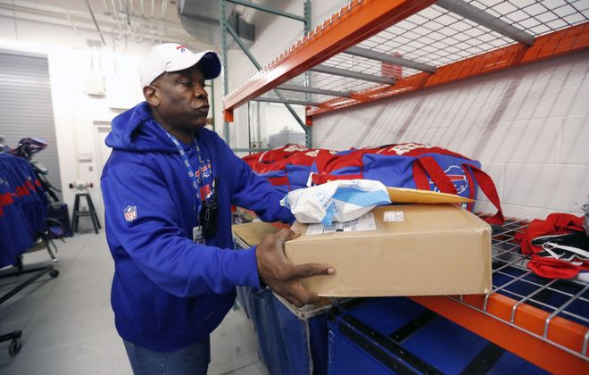 Rick Morrow, who has worked in the mail room at One Bills Drive for a dozen years, has left a positive impression on anyone he's met in the organization. (Mark Mulville/Buffalo News)