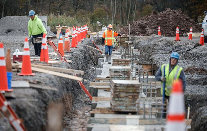 Crews work on the foundation for the Amazon delivery station in Riverview Solar Technology Park in Tonawanda on Oct. 25. (Derek Gee/Buffalo News)