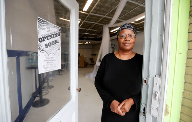 Linda Maddox-Muhammed stands in the doorway of the soon-to-be-opened Linda's Bean Pie Café on East Utica in Buffalo on Wednesday, Oct. 30, 2019.  (Mark Mulville/Buffalo News)