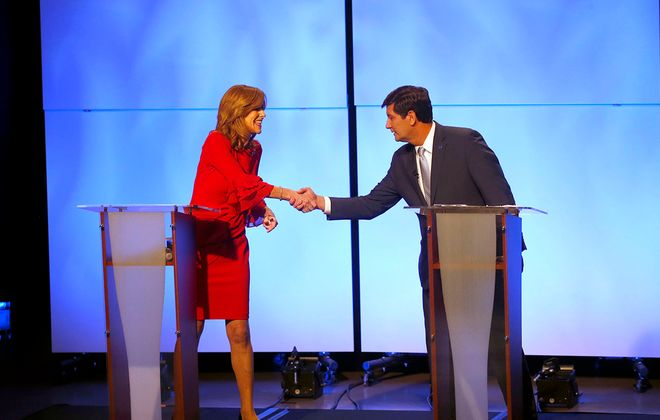 Lynne Dixon and Mark Poloncarz, candidates for Erie County executive, squared off at a debate Oct. 17 in the WNED studios. (Robert Kirkham/Buffalo News)