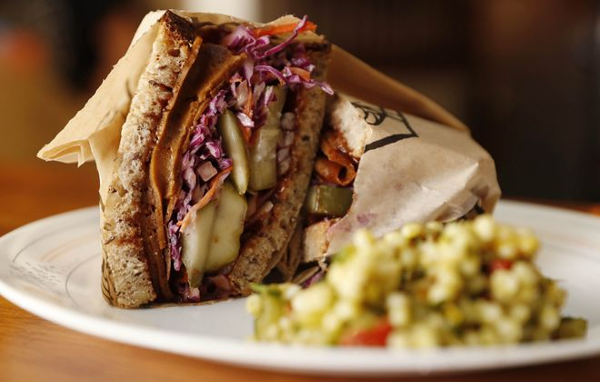 The Dolly is made with barbecue seitan, onion, Barrel + Brine pickles and slaw. (Sharon Cantillon/Buffalo News)