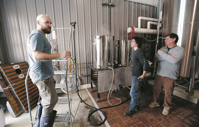 From left, Matt Matuszewski, head brewer at 42 North Brewing Company in East Aurora, and Canadians Joel Porter and master Brewer Rob Creighton, of of Shawn & Ed's Brewing Company in Dundas, Ont., worked on a collaborative beer at 42 North in the spring of 2018. The beer was supposed to be served during the inaugural Can-Am Beer Festival that April in Niagara Falls, N.Y., but Canadian import regulatory hurdles scuttled that plan. A smaller festival Tuesday on the Canadian side is designed to bring off a bigger annual festival in years to come. (Robert Kirkham/Buffalo News)