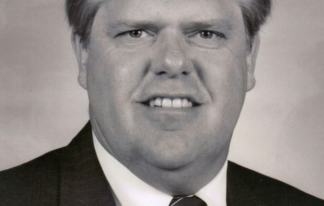 John T. Crane, 68, longtime owner of Crane Tax Service Corp.