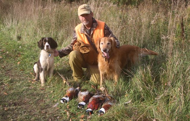 Get ready for pheasant hunting season. Here's Joel Spring of Ransomville after a  successful hunt last year. (Bill Hilts, Jr./Buffalo News)