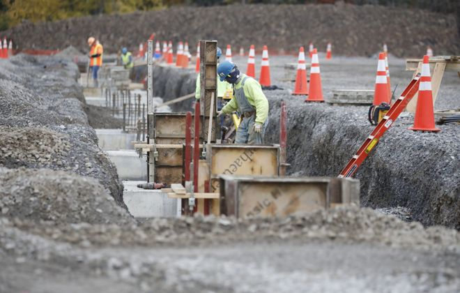 Workers prepare the foundation for Amazon's Tonawanda facility. (Derek Gee/Buffalo News)