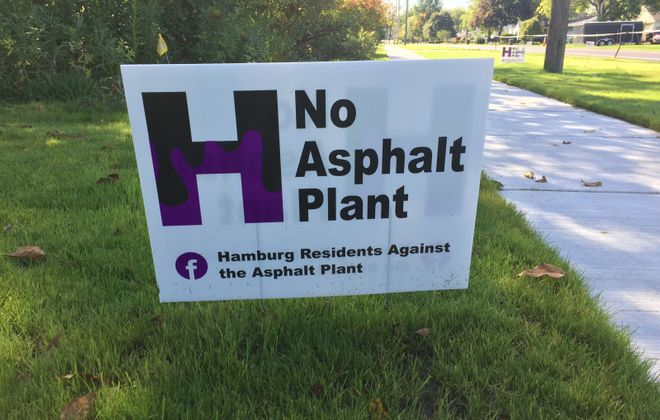 Signs dot lawns in Hamburg opposing a proposed asphalt plant. (Barbara O'Brien/Buffalo News)