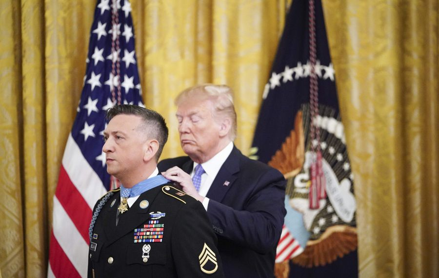 President Trump presents the Medal of Honor to Iraq War hero David Bellavia during a White House ceremony in June. Now the two are talking about Bellavia's future amid speculation about whether he will run for the congressional seat vacated by Chris Collins. (Getty Images)