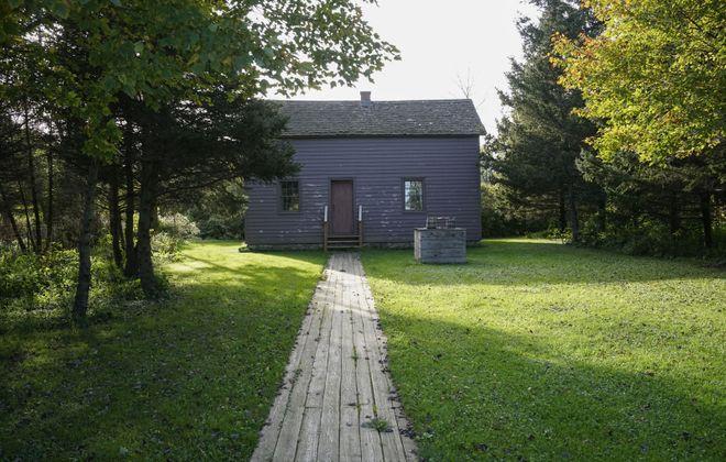The Schmitt Log House in the Buffalo Niagara Heritage Village. (Derek Gee/Buffalo News)