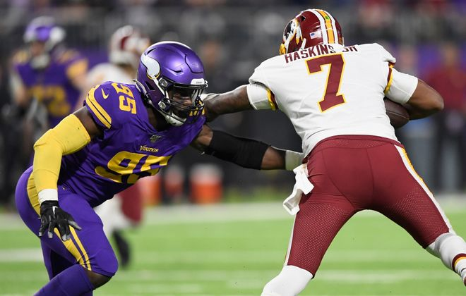 Washington will likely start rookie quarterback Dwayne Haskins (7) against Buffalo Sunday. Here, Ifeadi Odenigbo #95 of the Minnesota Vikings wraps up Haskins Oct. 24 in Minneapolis. The Vikings defeated the Redskins 19-9.   (Getty Images)