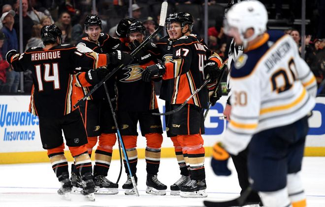 Jakob Silfverberg (33) of the Anaheim Ducks celebrates his empty-net goal with his teammates, to take a 5-2 lead over the Buffalo Sabres during the third period Wednesday at Honda Center in Anaheim, Calif. (Harry How/Getty Images)