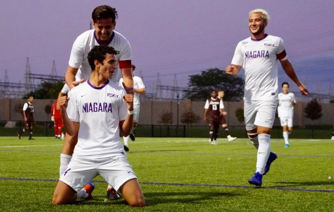 Niagara forward Rodrigo Almeida, foreground, celebrates his goal against St. Bonaventure. (Ben Tsujimoto/Buffalo News)