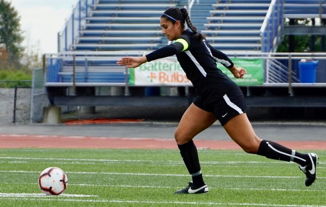UB center back Gurjeena Jandu has been a captain for two years - and she's dealt with her share of adversity on the field. (Ben Tsujimoto/Buffalo News)
