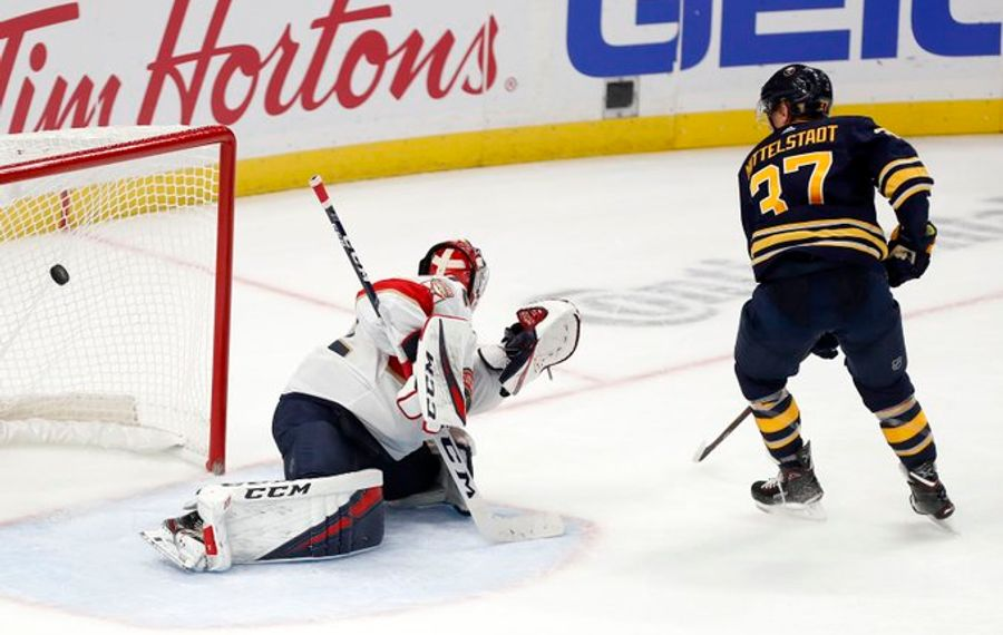 Buffalo Sabres center Casey Mittelstadt (37) slips the puck past Florida Panthers goaltender Sergei Bobrovsky (72) to win the game 3-2 in the shootout period at the KeyBank Center in Buffalo Friday, October 11, 2019. (Mark Mulville/Buffalo News)