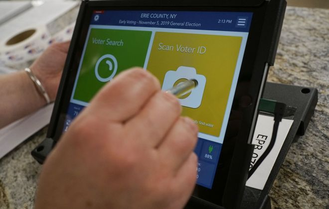 Poll inspectors will use a new tablet system instead of the traditional polling site books to sign in voters during the new early voting system in New York State, which runs from Saturday, Oct. 26 through Sunday, Nov. 3. (Derek Gee/Buffalo News)