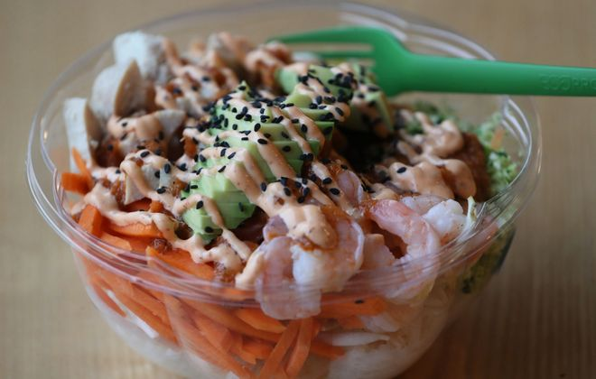 Fresh Catch Poke's Surf & Turf is one of the deluxe bowls. It's made with antibiotic-free chicken, shrimp, jasmine rice, avocado, carrots, peas, bean sprouts, spicy ginger citrus and spicy mayo. (Sharon Cantillon/News file photo)