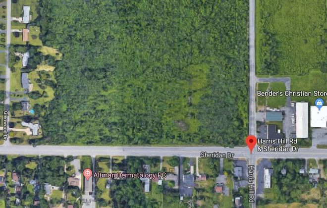 A group of developers plans to build 76 apartment units and commercial space on this property on the north side of Sheridan Drive between Harris Hill Road and Glenwood Drive. (Google)