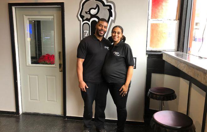 Jamey Alexander, left, and his wife, Brandy, run Buffalo Soul Catering at 454 Pearl St. (Ben Tsujimoto/Buffalo News)