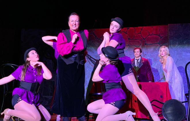 """Pamela Rose Mangus, in the pink shirt and vest, gives a winning and energetic performance as Frau Blucher in O'Connell and Company's production of """"Young Frankenstein."""""""