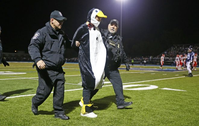 A Lancaster student was arrested in a Penguin outfit after running onto the field during Depew's game against Lancaster at Depew High School on Friday, Oct. 18, 2019. This marks 100 years of the Lancaster-Depew  football rivalry. (Harry Scull Jr./Buffalo News)