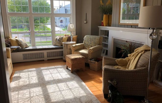 The bright living room with window seat at the Capuana home. (Photo courtesy of Jan Capuana)