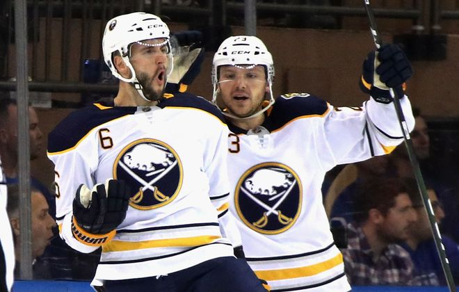 Marco Scandella (6) celebrates his second-period goal with Sam Reinhart Thursday in Madison Square Garden (Getty Images).