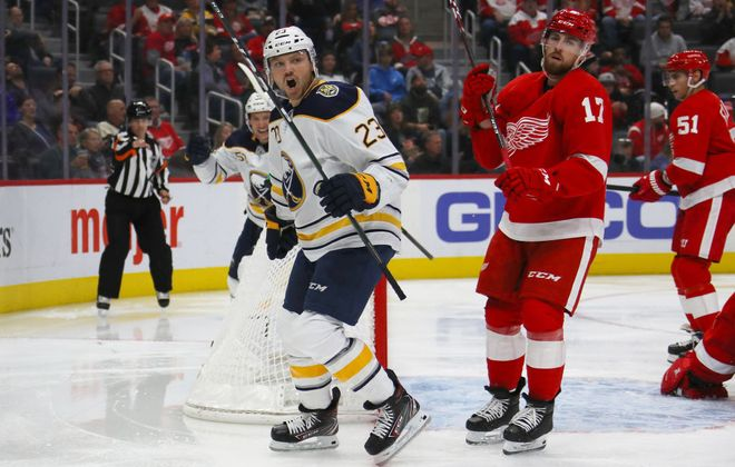 Sam Reinhart celebrates his third-period goal on the power play in front of Detroit's Filip Hronek (17) Friday in Little Caesars Arena (Getty Images).
