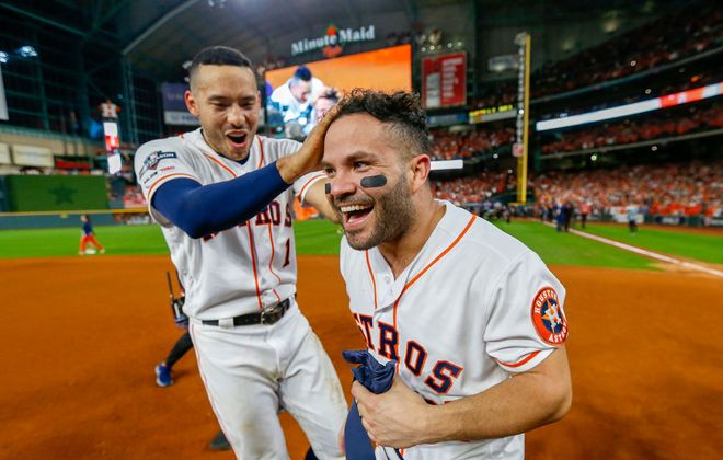 Carlos Correa, left, and Jose Altuve are all smiles after Altuve's walkoff home run ousted the Yankees from the ALCS on Saturday night (Getty Images).