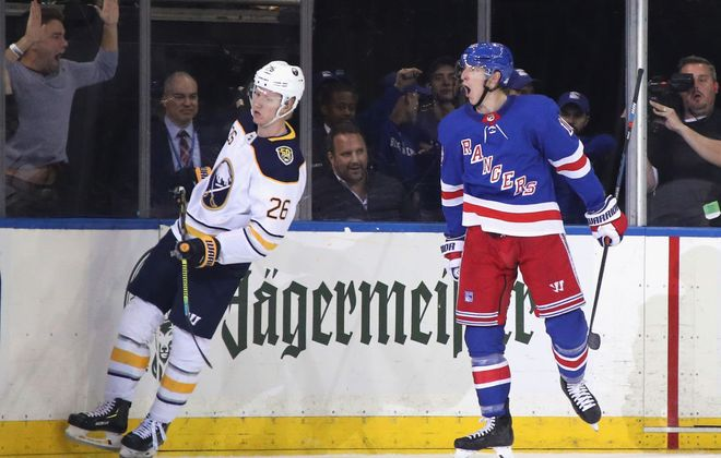 Ryan Strome of the Rangers celebrates his third-period goal as Rasmus Dahlin skates away dejectedly during the Sabres' 6-2 loss Thursday night in New  York (Getty Images).