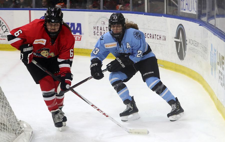 Corinne Buie battles Metropolitan Riveters Courtney Burke for the puck in the second period at Harborcenter in Buffalo,  on Saturday, Jan. 12, 2019.  (James P. McCoy/Buffalo News)