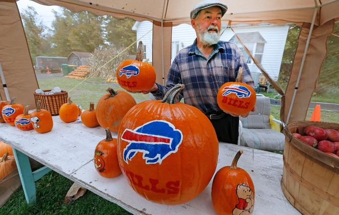 Ron Nagel Sr., 76, with his pumpkins at his front yard stand in Holland. (Robert Kirkham/Buffalo News)