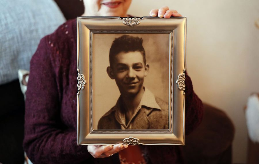 Darlene Cooley holds a photo of her uncle, U.S. Army Sgt. Gerald B. Raeymacker, at her home in Dunkirk. A memorial service for Raeymacker was held Saturday in Dunkirk; he died in 1950 in the Korean War. His remains were returned by North Korea and positively identified this summer, 69 years after his death. (Mark Mulville/Buffalo News)