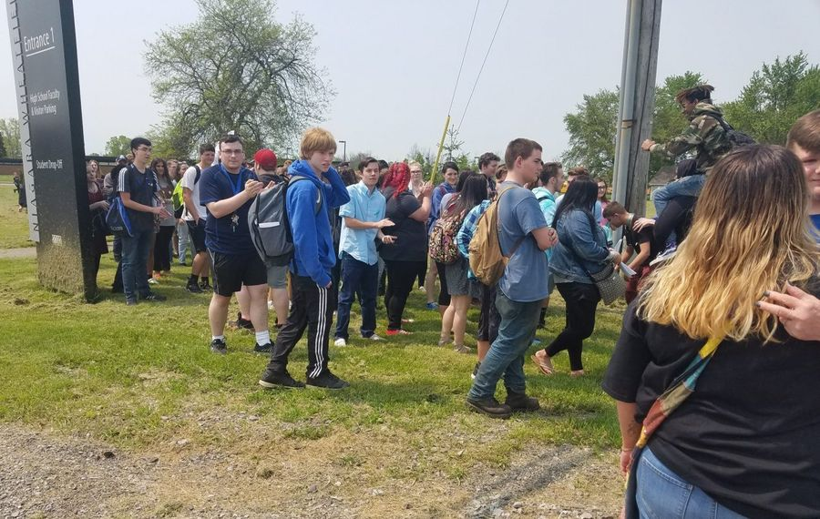"""Around 100 students took part in a walkout at Niagara Wheatfield High School in June despite an announcement by Principal Michael Mann of """"consequences."""" (Thomas J. Prohaska/News file photo)"""