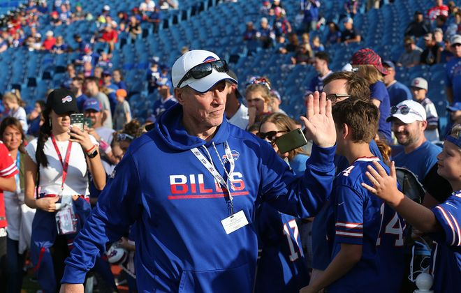 Jim Kelly high-fives with fans at New Era Field in August. (James P. McCoy/Buffalo News)