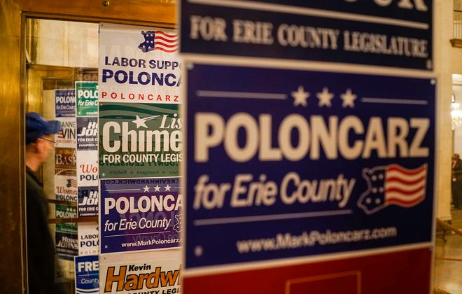 Campaign signs line the doors to the Golden Ballroom for the Democratic Party's election night celebration at Statler City, Tuesday, Nov. 5, 2019. (Derek Gee/Buffalo News)