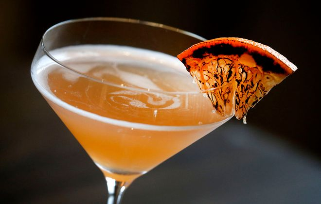 A cocktail with a torched orange slice at Jazzboline Restaurant & Bar in Amherst. (Robert Kirkham/Buffalo News)