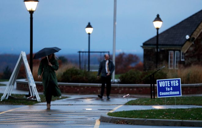 Voters brave the weather at The Chestnut Ridge Park Casino in Orchard Park early Tuesday, November 5, 2019.  Orchard Park voters are voting today on wether to upsize the Town Board.      (Mark Mulville/Buffalo News)