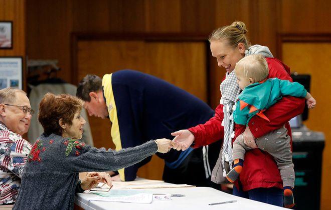 Amanda Murphy votes with her son, Cullen Murphy, at the Hamburg Village Community Center on Tuesday, Nov. 5, 2019. (Mark Mulville/Buffalo News)