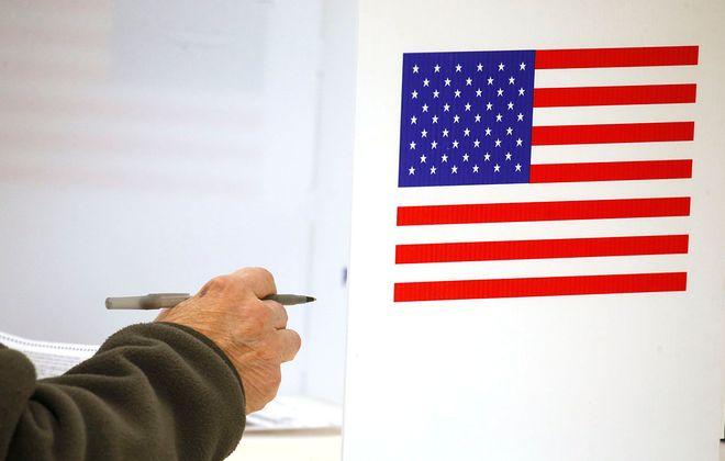 Voters at the Bellevue Volunteer Fire Hall polling place in Cheektowaga on Nov. 5. (Robert Kirkham/Buffalo News)