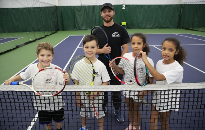 Collin Mika, Oliver Zinaja, and twins Mya and Rya Johnson are 8-year-old budding tennis stars with coach Nate Palmer at the Miller Tennis Center on Wednesday, Nov. 6, 2019. (Harry Scull Jr./Buffalo News)