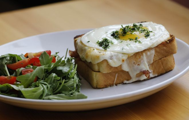 The croque madame with a house salad on the side at Mon Ami. (Derek Gee/Buffalo News)