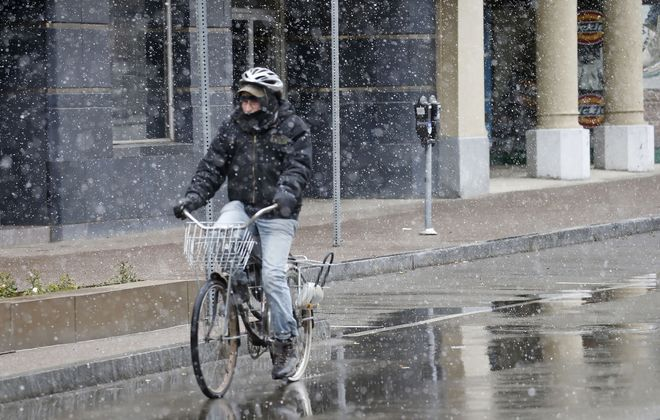 The biking – and driving – is expected to be more difficult Monday than last Thursday, when this bicyclist and Western New York saw the first snow of the season. (Robert Kirkham/Buffalo News)