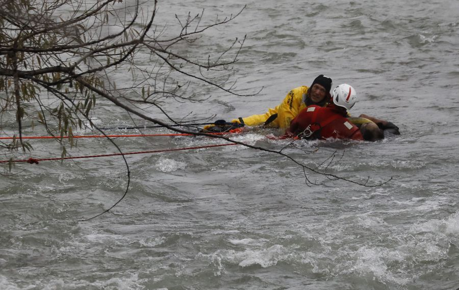 State Park Police Major Clyde Doty, in yellow, and Niagara Falls firefighter Aaron Malstrom rescued a man in the upper Niagara River about 75 yards from the brink of Niagara Falls on Thursday afternoon. (Derek Gee/Buffalo News)